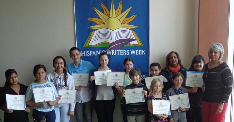 Joseph J. Hurley School students displaying their Hispanic Writers Week certificates