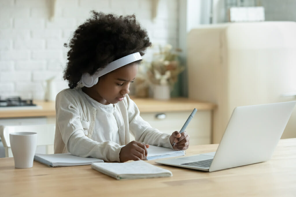 Young black girl distance learning
