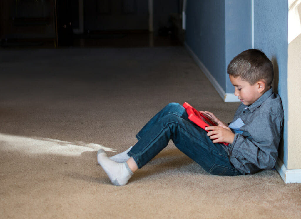 Young Latino Boy Using Tablet