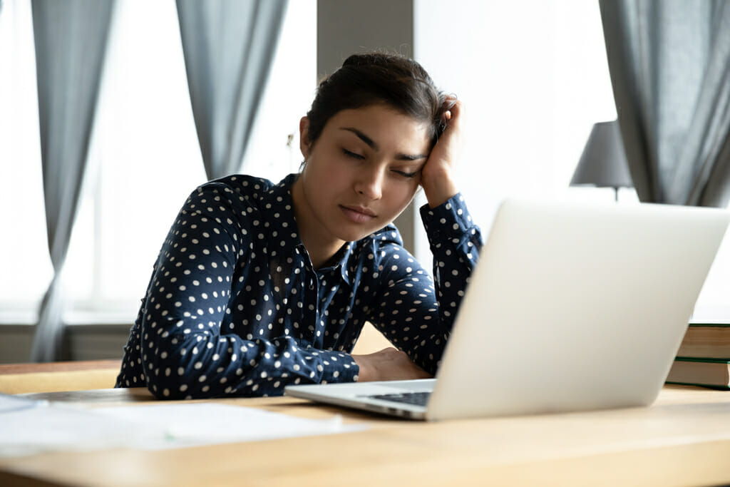 Exhausted Teenage Indian Girl at Laptop